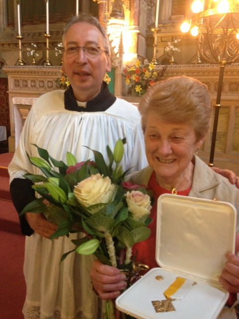 Margaret Grierson with her medal following the presentation by Fr Kevin Murray.